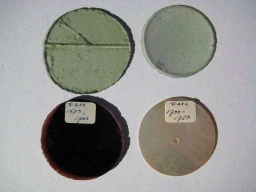 Assorted lenses - 17th. and early 18th. century - Bottom right lens made of shell with aperature in middle.