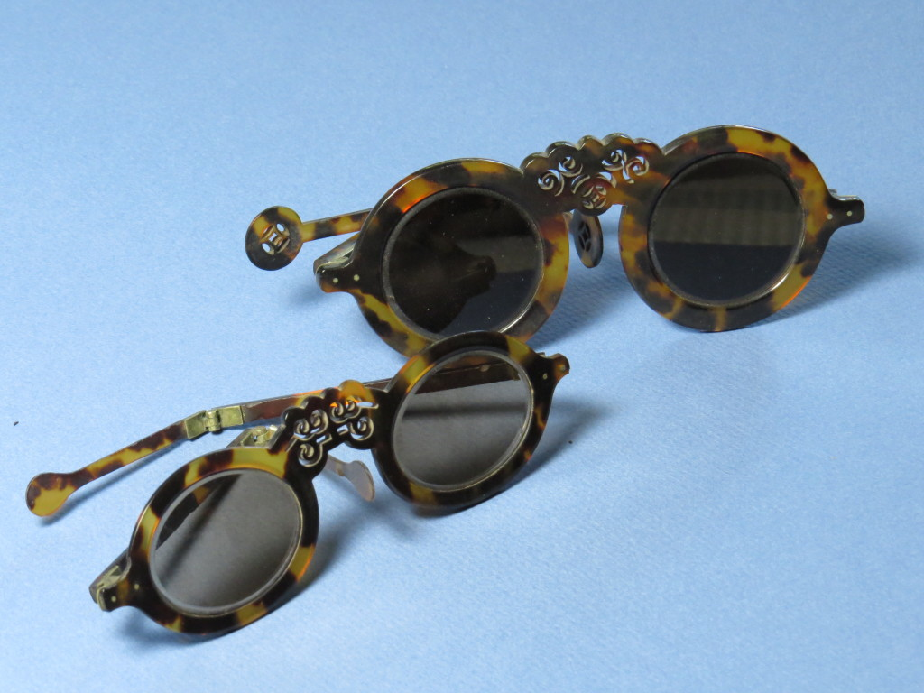 Beautiful hand carved tortoiseshell. Smoked crystal lenses.